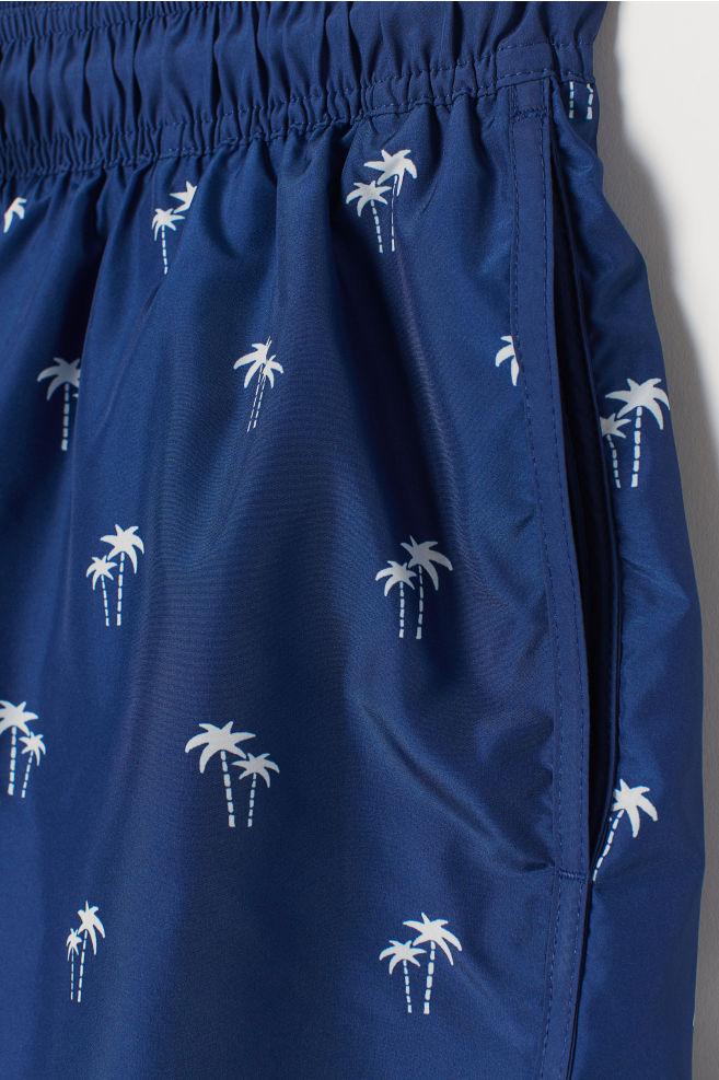 18471a0a8788 ... Short Patterned Swim Shorts - Dark blue/palm trees -   H&M ...