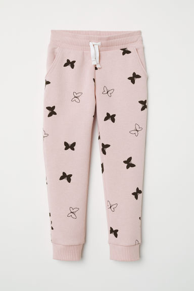 Joggers - Powder pink/butterflies - Kids | H&M US
