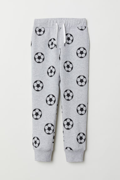 Joggers - Light grey marl/Footballs - Kids | H&M