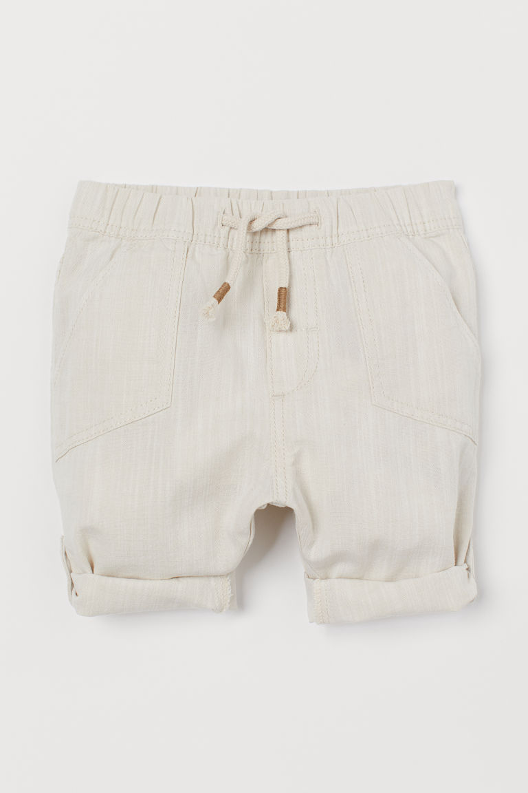 Roll-up cotton trousers - Natural white - Kids | H&M IN