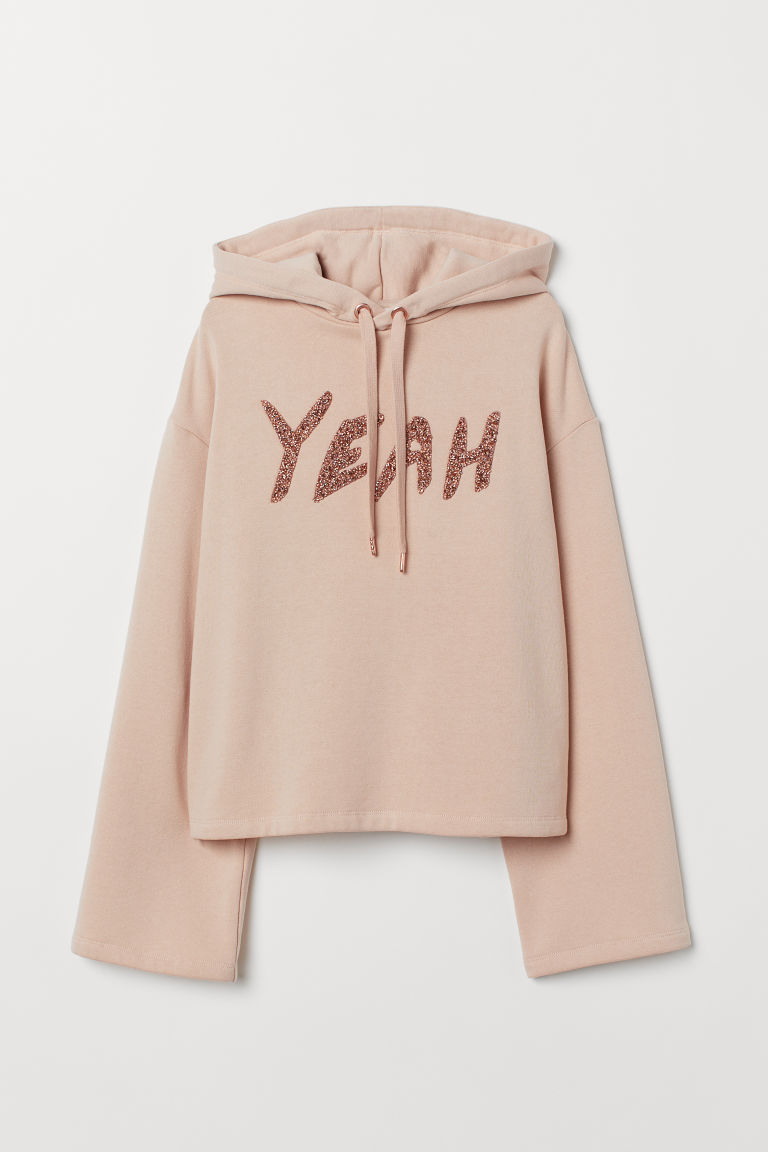 Boxy hooded top - Powder beige/Yeah - Ladies | H&M IE