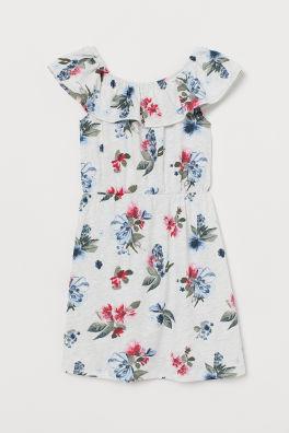 a6f97e12a1ed Vzorované džersejové šaty