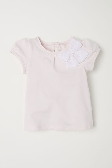 Jersey top with a bow - Light pink - Kids | H&M