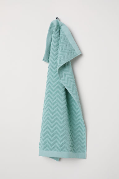 Jacquard-patterned hand towel - Light turquoise - Home All | H&M CN