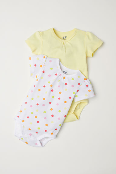 2-pack bodysuits - Light yellow/Spotted - Kids | H&M