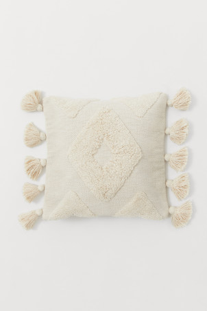 Cushion cover with tassels