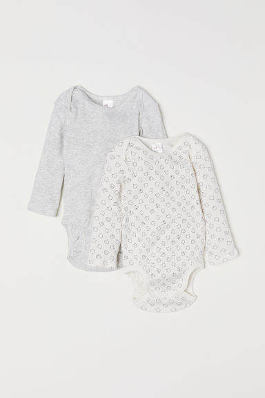 2-pack ribbed bodysuits - Natural white/Patterned - Kids | H&M