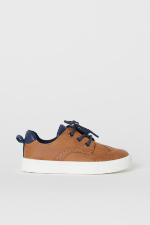 Brogue-patterned trainers