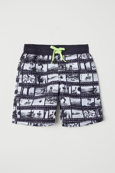 Patterned swim shorts - Black/Film reel - Kids | H&M