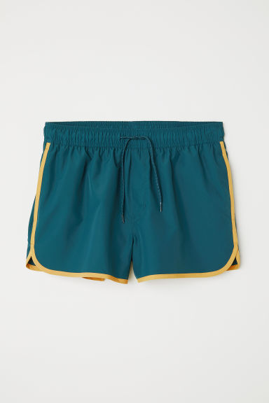 rencontrer vêtements de sport de performance 2019 authentique Short de bain court