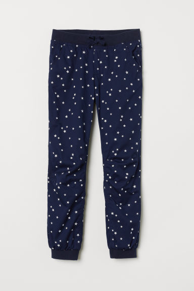 Jersey-lined pull-on trousers - Dark blue/Stars - Kids | H&M CN