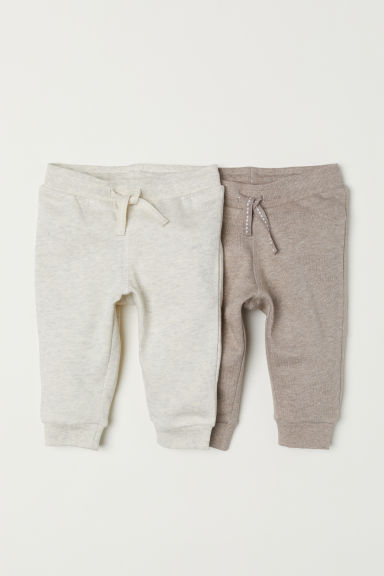 2-pack joggers - Light grey marl/Beige marl - Kids | H&M