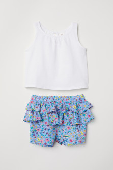 Top and frilled shorts