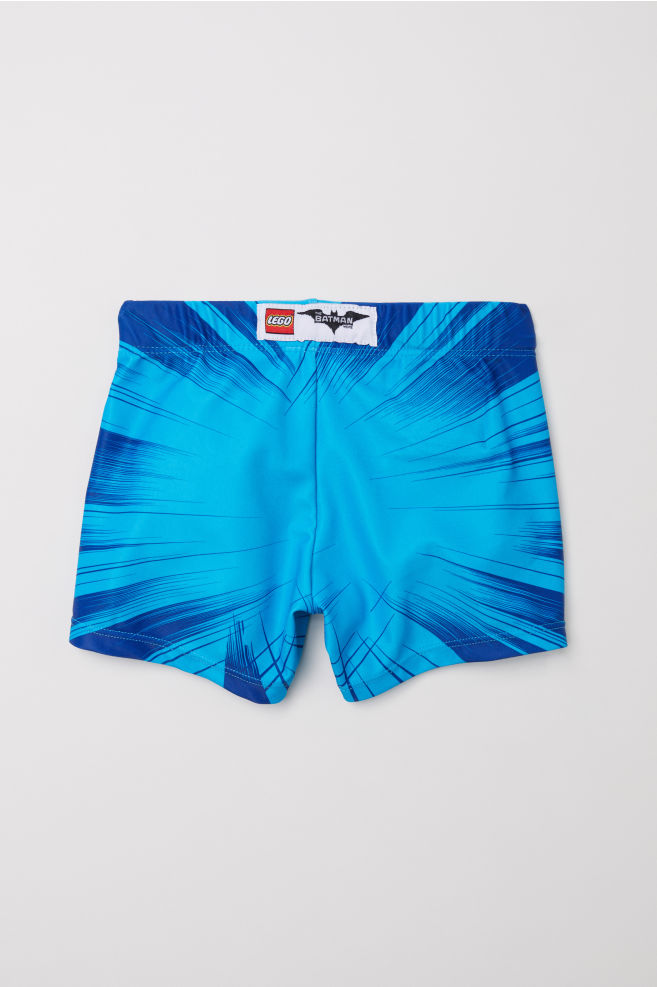2de641d40d Printed swimming trunks - Turquoise/Lego Batman - Kids | H&M ...