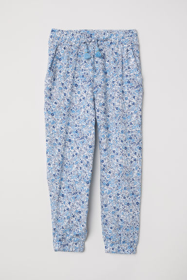 Patterned pull-on trousers - White/Floral - Kids | H&M