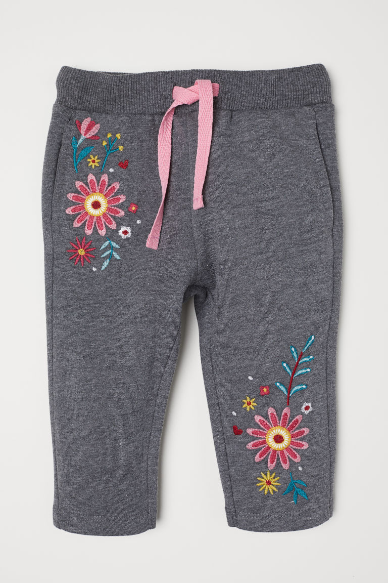 Trousers with a motif - Dark grey marl/Flowers - Kids | H&M