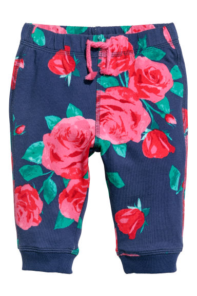 Patterned joggers - Dark blue/Flowers - Kids | H&M CN