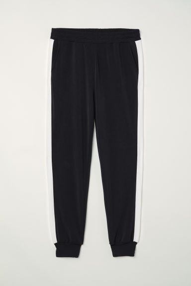 Pull-on side-striped trousers - Black/White - Ladies | H&M