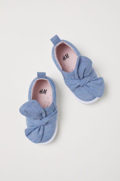 Slip-on trainers with a bow - Light blue/Chambray - Kids | H&M