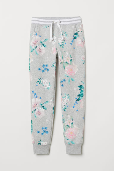 Printed joggers - Light grey marl/Floral - Kids | H&M