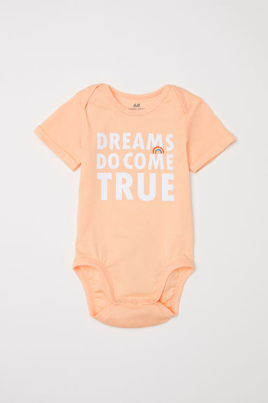 Printed short-sleeved bodysuit - Light orange/Dreams - Kids | H&M CN