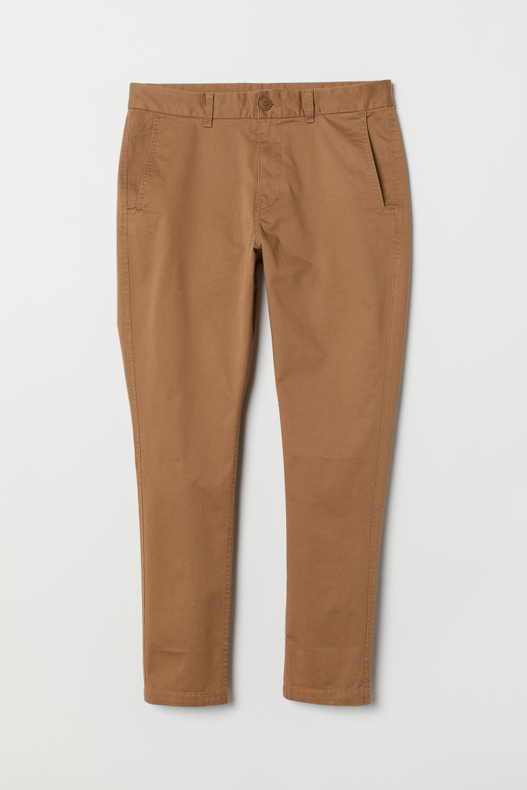 Chinos Tapered Fit - Beige oscuro - HOMBRE | H&M ES