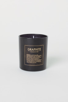 Scented candle in a glass jarModel