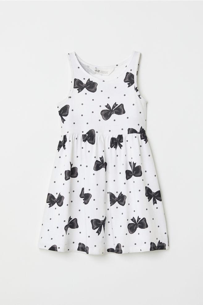 a3462e7f2d63db Mouwloze tricot jurk - Wit strikjes - KINDEREN