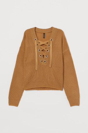 Knitted jumper with lacing