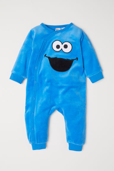 Velour all-in-one pyjamas - Bright blue/Sesame Street - Kids | H&M
