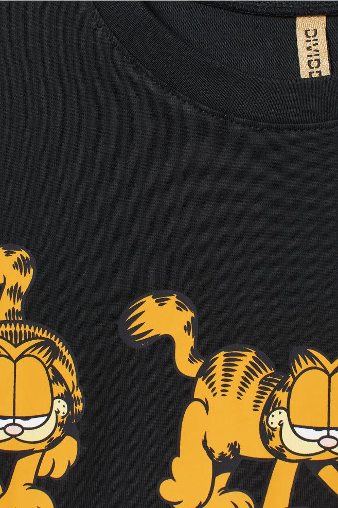 b79c329fe24d ... Wide T-shirt dress - Black/Garfield - | H&M ...