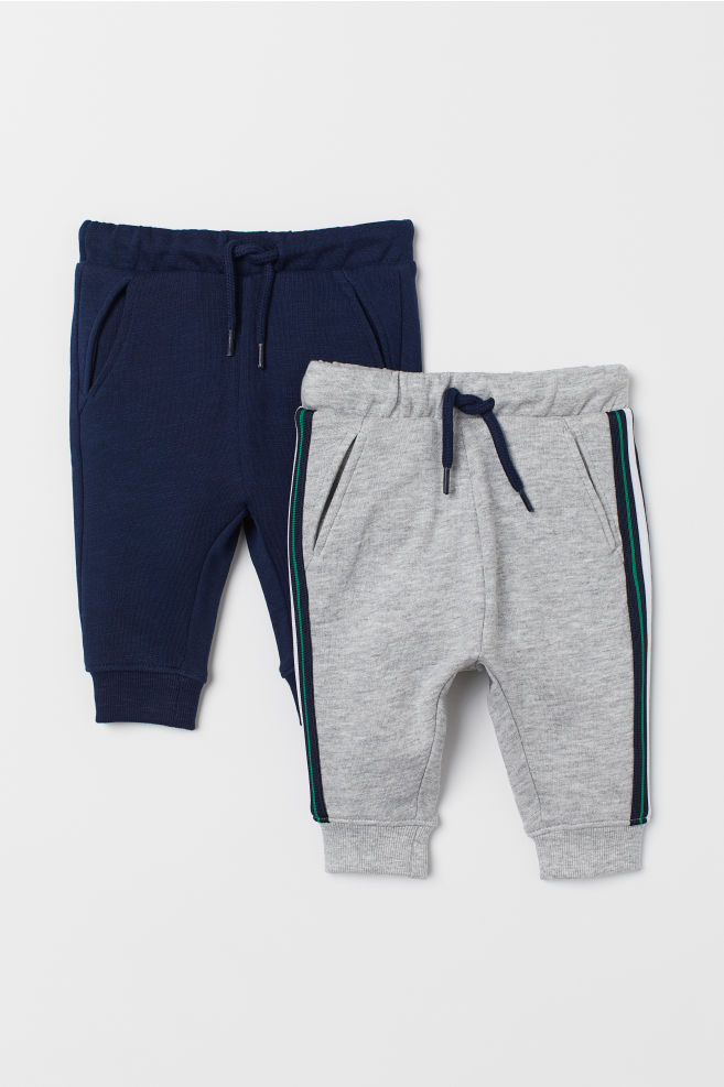 e98769b369f0 2-pack cotton joggers - Grey marl/Dark blue - Kids | H&M GB