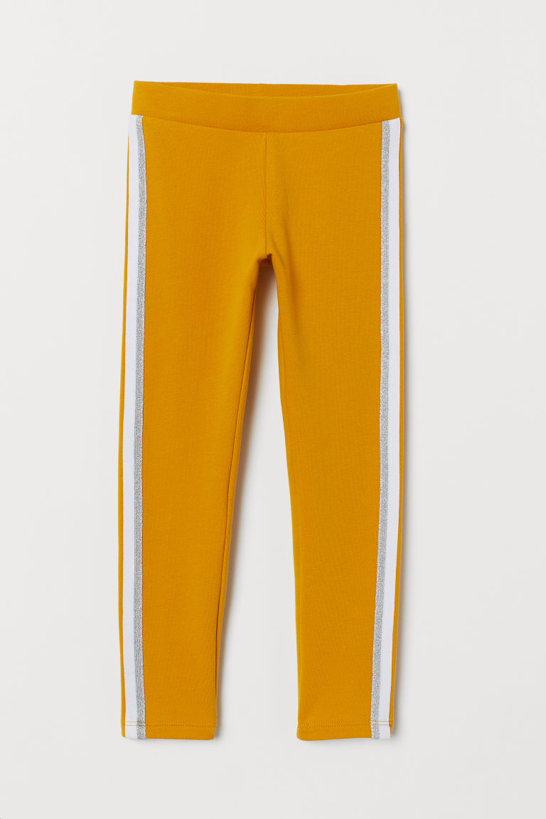 Leggings with brushed inside - Yellow/Glittery - Kids | H&M IN