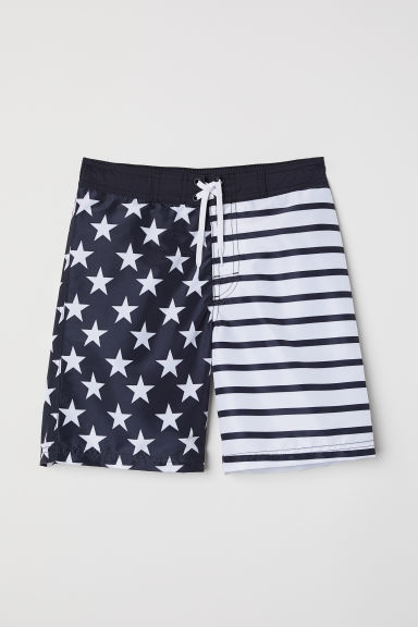 Printed swim shorts - Black/Stars - Kids | H&M CN