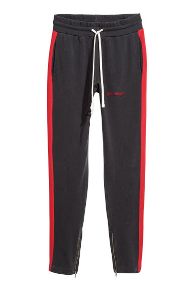 Sweatpants with side stripes - Black/Red - Men | H&M