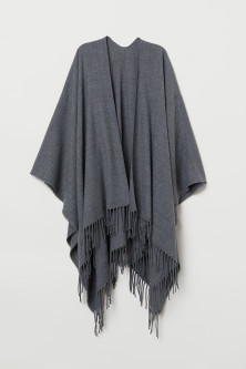 Woven poncho with fringes