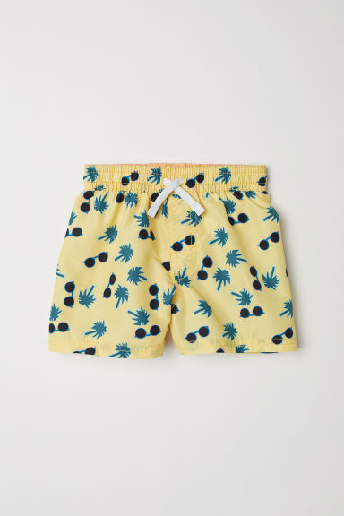 Patterned swim shorts - Light yellow/Sunglasses - Kids | H&M
