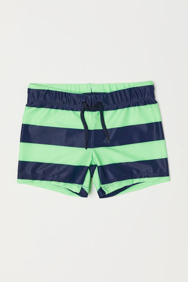 Patterned swimming trunks - Dark blue/Green striped - Kids | H&M CN