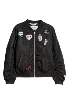 Bomber jacket with appliqués