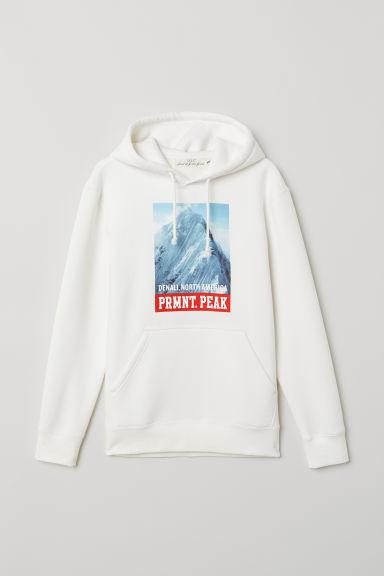 Hooded top with a motif - White/PRMNT. PEAK - Men | H&M