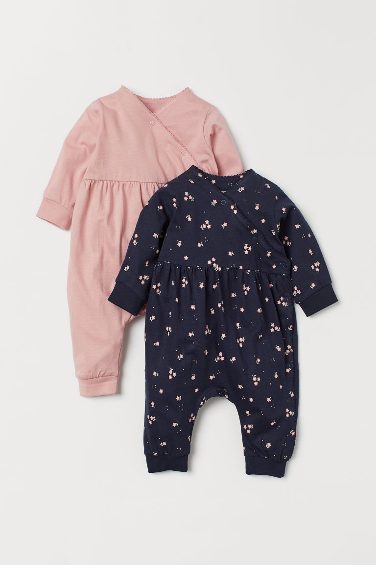 2-pack all-in-one pyjamas - Dark blue/Floral - Kids | H&M