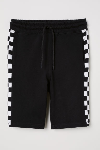 Patterned sweatshirt shorts - Black/Checked - Kids | H&M CN