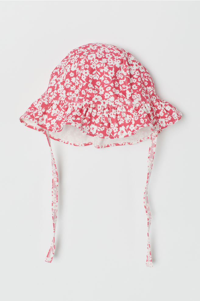9c097fe2ae5a5f Sun hat with UPF 50 - Dark pink/Floral - Kids | H&M ...