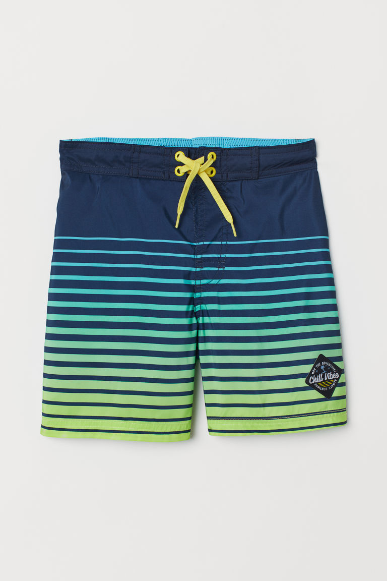 Patterned swim shorts - Dark blue/Green striped - Kids | H&M