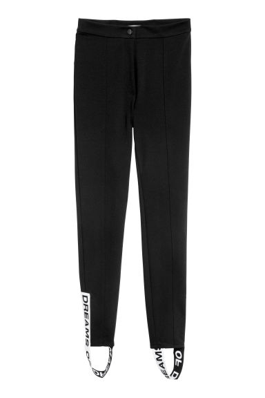 Trousers with foot straps - Black - Ladies | H&M CN