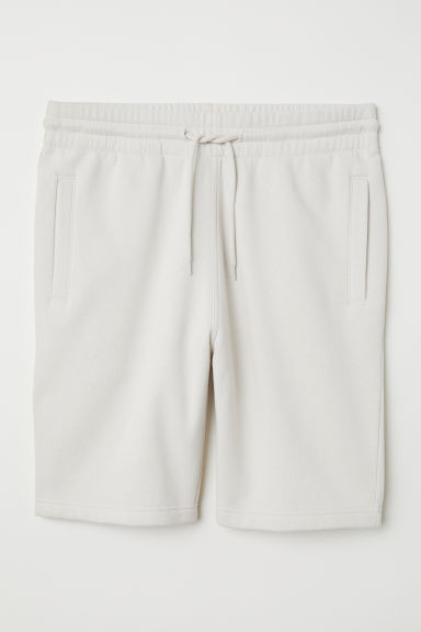 Short van joggingstof - Lichtbeige - HEREN | H&M BE
