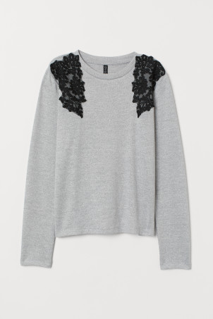 Jumper with lace decorations