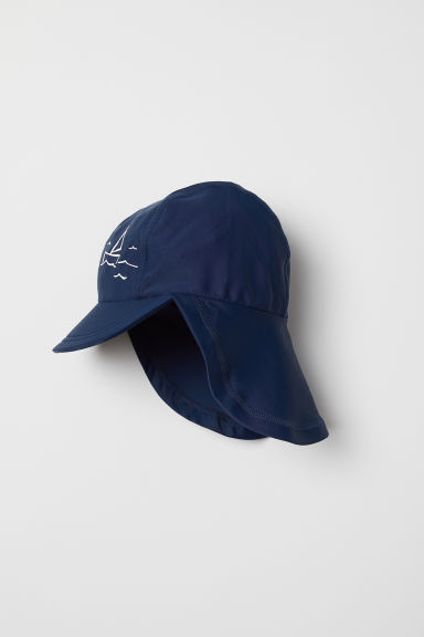 Sun cap with UPF 50 - Dark blue/Boat - Kids | H&M GB