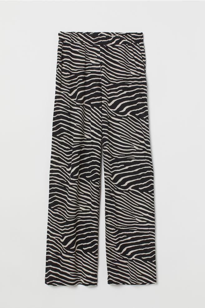 59ef4be39b ... Pantalón amplio de punto - Negro Estampado de cebra - MUJER