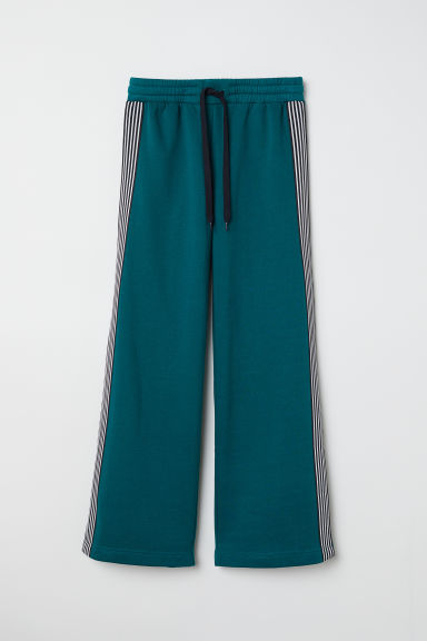 Sweatpants with side stripes - Dark green - Ladies | H&M CN